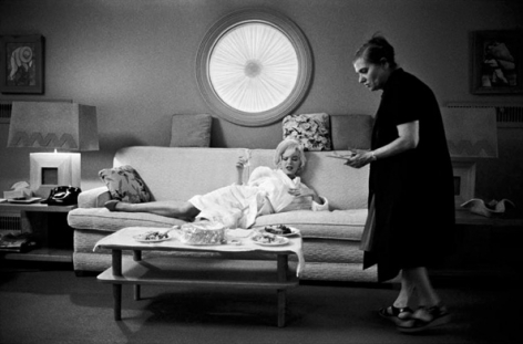 Marilyn Monroe (on couch) and Paula Strasberg, May, 1962