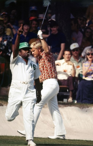 Jack Nicklaus with caddie Willie Peterson celebrate after making a birdie putt on the 16th green during Round 1, Masters Tournament at Augusta National GC, 1972, Color Photograph