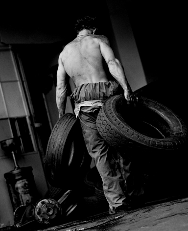 Fred with Tires III, Hollywood, 1984, 14 x 11 Inches, Silver Gelatin Photograph, Edition of 25