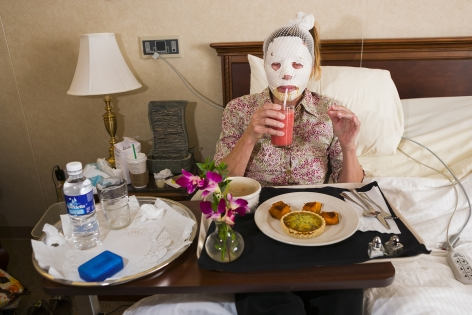 Dr. Steven Teitelbaum's forty-nine-year-old patient, who is recovering from a full-face laser resurfacing and an upper eye lift, eats lunch in a private room at Serenity, a luxury aftercare facility that offers private chefs, spa treatments, and twenty-four-hour nursing, Santa Monica, California, 2006, 20 x 30 inch - Archival Pigment Print - Ed. of 5