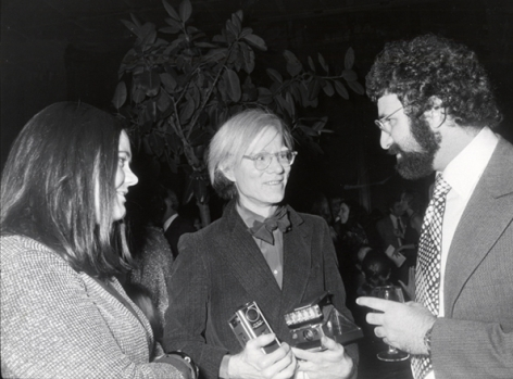 (Andy Warhol, with Polaroid Camera, and Friends), n.d., 16 x 20 Silver Gelatin Photograph