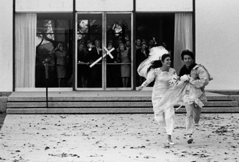 Katharine Ross & Dustin Hoffman running away from the church at the end of The Graduate, 1967