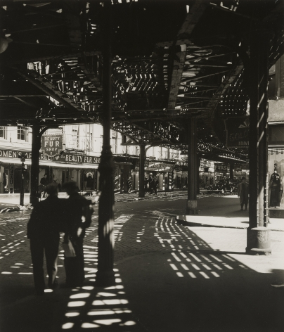 """BERENICE ABBOTT (1898–1991), """"El, Second and Third Avenue Lines, Bowery and Division Streets, Manhattan,"""" 1936. Gelatin silver print, 9 1/2 x 7 5/8 in."""