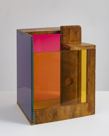 a sculpture by Sarah Braman of a cabinet draw fused with multi-colored glass panels