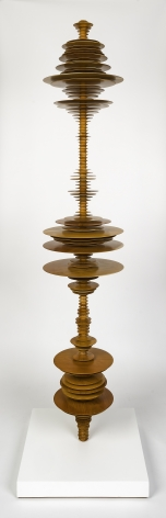 a sculpture by Elizabeth Turk of wood discs layered and arranged to resemble a sound wave and a modernist abstraction