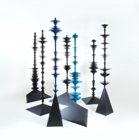 sculptures by Elizabeth Turk of black aluminum discs layered and arranged to resemble Modernist abstractions and a sound waves