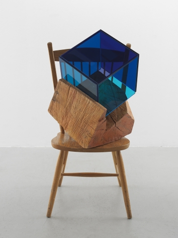 a sculpture by Sarah Braman of a dining chair fused with multi-colored glass panels