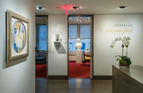 """""""American Cornucopia."""" Installation view of gallery's entrance foyer, showing, from left to right a Cubist still life by Suzy Frelinghuysen, a patinated bronze make by Gaston Lachaise, and a marble bust of """"Ariadne"""" by Chauncey B. Ives."""