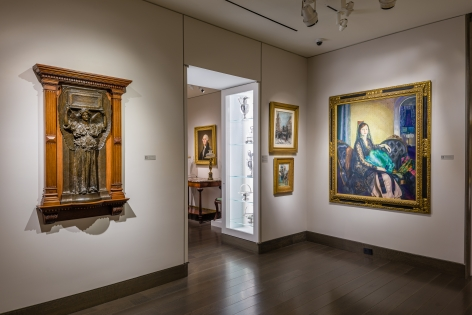 """""""American Cornucopia."""" Installation view showing, from left to right, a bronze sculpture by Augustus Saint-Gaudens, a Gilbert Stuart portrait of George Washington, and a George Bellows portrait of Elizabeth Alexander."""