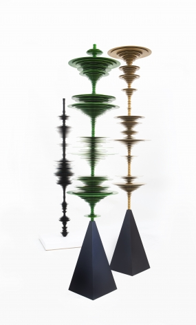 sculptures by Elizabeth Turk of colored aluminum discs layered and arranged to resemble Modernist abstractions and a sound waves