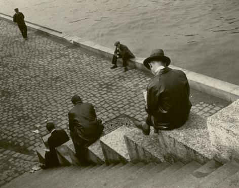 ilse bing Three Men Sitting on Steps at the Seine, Paris 1931