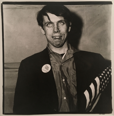 Diane Arbus, Patriotic Young Man with a Flag, N.Y.C., 1967
