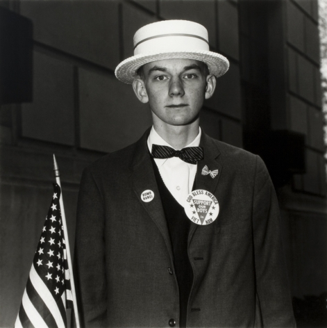 Diane Arbus, Boy with a Straw Hat Waiting to March in a Pro-War Parade, NYC, 1967
