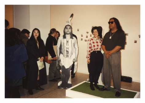 Take a Picture with a Real Indian, 1991, Chromogenic silver gelatin, and Polaroid prints, nails, wood, artificial turf, tripod, Polaroid camera, Polaroid film, tape recorder, audio cassette, sound, vinyl text, and chairs