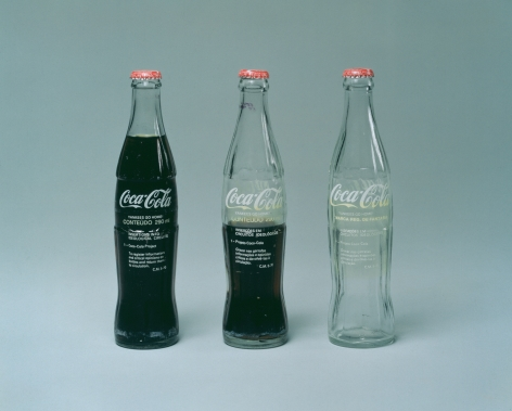 Cildo Meireles  Insertions into Ideological Circuits: Coca-Cola Project, 1970  Three glass bottles, metal caps, liquid, and adhesive labels with text  Each: 7 inches (24.1 x 17.8 cm)