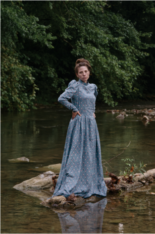 Stacy Kranitz  Stacy as Christy, 2012   Archival pigment print 16 x 24 inches, Edition of 7  27 x 40 inches, Edition of 3, Woman posing in period dress on a rock in a river.