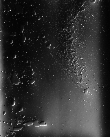 Ben Nixon  Sea Change, 2016  Silver Gelatin Photogram  24h x 20w in. a photogram depicting droplets and splatter marks in a greyscale color scheme
