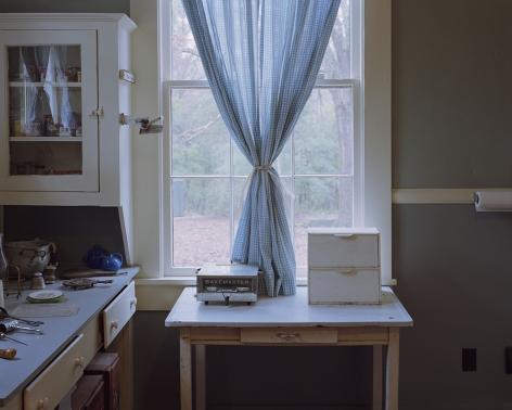 Tema Stauffer  William Faulkner's Kitchen Curtains, Rowan Oak, Oxford, MS, 2018  Archival Pigment Print  42h x 50 1/2w in. Photograph of William Faulkners Kitchen with blue gingham curtains