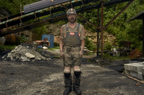 Stacy Kranitz  Fed's Creek, Kentucky, 2011  Archival pigment print  16 x 24 inches, Edition of 7  27 x 40 inches, Edition of 3, Coal miner in front of piles.
