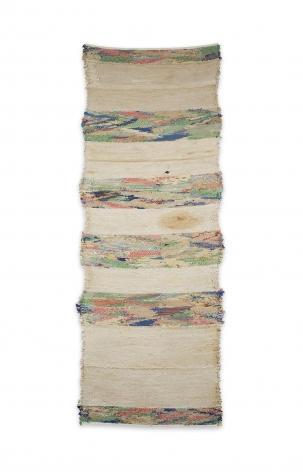 large fiberwork in muted cream and with bands of multiple primary colored lines.