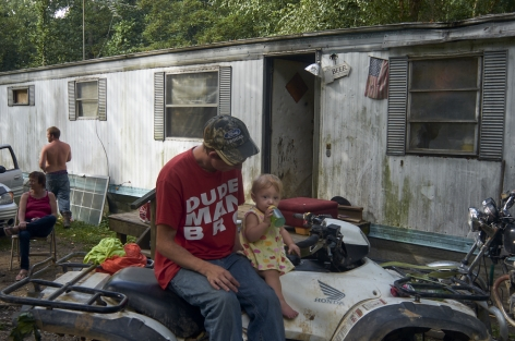 West Columbia, West Virginia, 2013  Archival Pigment Print, 16 x 24 inches, Edition of 7  27 x 40 inches, Edition of 3, Man on ATV, in front of a mobile home, West Virginia