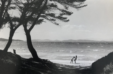 Bernard Plossu (1945-)  Untitled (Playing on beach, two trees), n.d.  Gelatin silver print  12 x 16 inches (paper) 8 x 11.5 inches (image), Black and White Photography