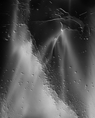Ben Nixon  Morning Light, 2016  Silver Gelatin Photogram  24h x 20w in. an image consisting of a large area of a light gray contrasted with an almost black area dusted with liquid splatter