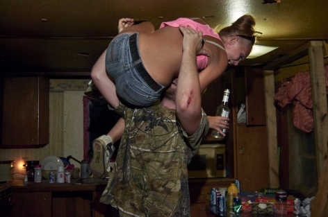 Stacy Kranitz  West Columbia, West Virginia, 2013  Archival Pigment Print  16 x 24 inches, Edition of 7  27 x 40 inches, Edition of 3, Man lifting up woman in jeans, West Viginia