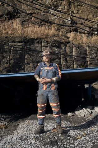 Stacy Kranitz  Welch, West Virginia, 2016  Archival Pigment Print  16 x 24 inches, Edition of 7  27 x 40 inches, Edition of 3, Vertical coal miner, with pipe behind him, West Virginia
