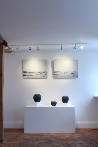 Paintings by Charlie Leal, ceramics by Patricia Shone