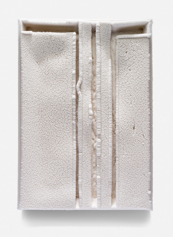 """Cary Esser, Parfleche (w3), earthenware and glaze, 16.9"""" x 11.9"""" x 2.1"""", 2017, rectangular ceramic """"parfleche"""" in a rich warm white, with three strong vertical indentations and a strong horizontal void space at the top"""