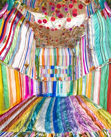 """Raissa Venables """"Sukkah"""" large scale photograph of a Bedouin-like tent collaboration piece with Rachel Hayes fabric work - striped and very colorful"""