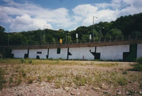 "Oliver Laric mural of text ""TRUST"""