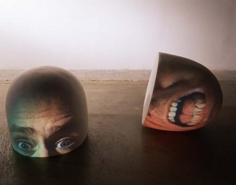Tony Oursler, Half (Brain), 1998. 2 Sony CPJ 200 projector, 2 videotape, 2 Samsung VCR, polystyrene foam, paint; performance by Tony Oursler. 14 x 13 x 13 inches each (plus equipment). MP 241