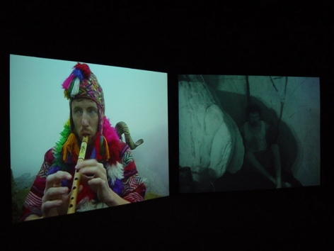 """Installation view from """"Home,"""" 2003. Dual screen DVD shot with digital camera, 32 minutes. Edition of 5. MP V-7"""