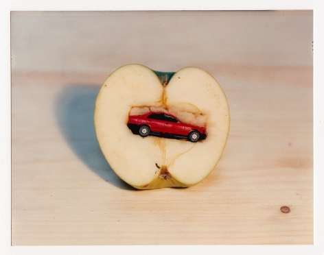 Olaf Breuning photograph of a toy car inside an apple