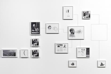 Alexandre Singh installation of arranged framed inkjet prints