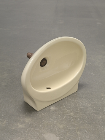 Plug, 2018. Ceramic sink, hand-rolled cigar,