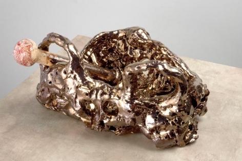 Death Cult Gold, 2007. Ceramic, formica pedestal. Sculpture - 7.5 x 13 x 9 inches (19.1 x 33 x 22.9 cm); pedestal: 31 x 19 x 19 inches (78.7 x 48.3 x 48.3 cm). MP 33