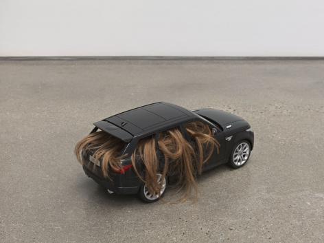 Nina Beier, Automobile, 2018. Remote control car, human hair wig, dimensions variable.