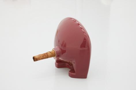 Plug, 2018. Ceramic sink, hand-rolled cigar, 16 x 17 x 13 1/2 inches (40.6 x 43.2 x 34.3 cm).