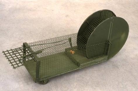 Fox of Dog Trap, 1998. Metal, bait, (trap) 18-1/2 x 14-1/4 x 14-1/4 inches. MP 7
