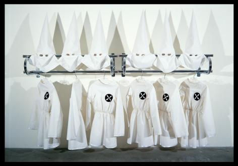 Gary Simmons installation of 6 KKK costumes on a rack
