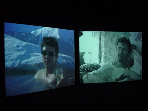 "Installation view from ""Home,"" 2003. Dual screen DVD shot with digital camera, 32 minutes. Edition of 5. MP V-7"
