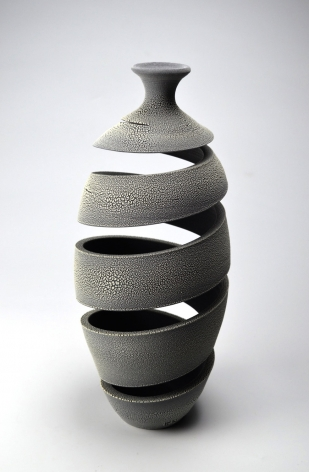 Ceramic vase sculpture by Michael Boroniec tilted Spatial Spiral; Crawl, 2018, Earthenware with black, white and gray crackle glaze measuring 14.5 x 6.25 x 6.25 inches