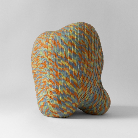 Ceramic sculpture by Janny Baek titled Plush, colored porcelain with orange yellow blue weave pattern