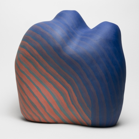 Ceramic sculpture by Janny Baek titled Blue Flare, Colored porcelain w/layered blue and red gradient pattern, 13 x 13 x 11 in