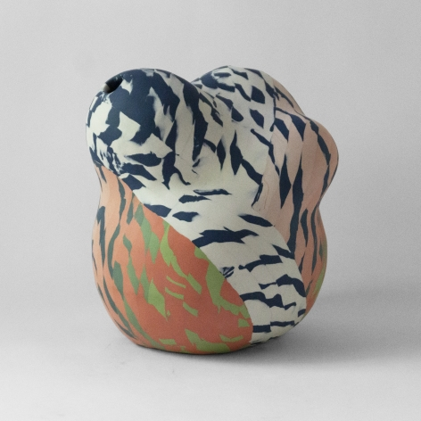 Ceramic sculpture by Janny Baek titled Flushed porcelain w/layered orante, white green gradient pattern, glazed interior, 10 x 9 x 9 in