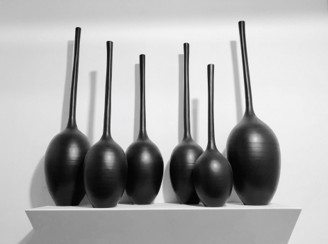 Ceramic vase sculptures by Michael Boroniec tilted Gourd Vessels installation view, 2019, Ceramic with black glaze measuring approximately 56 x 26 x 10 inches