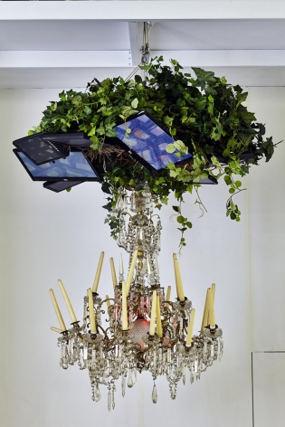 , NAM JUNE PAIKVideo Chandelier No. 4,1990Video monitors, chandelier, candles, tree leaves59 x 59 x 59 in. (150 x 150 x 150 cm)
